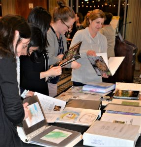Professional early childhood educators scrutinize documentation of students' learning collected by Meredith Dodd as part of her work at University of Chicago Laboratory School